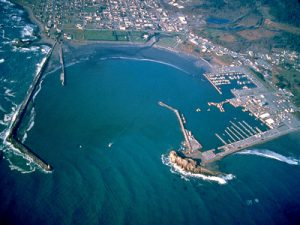 Aerial photo of Crescent City Harbor By Robert Campbell [GFDL (http://www.gnu.org/copyleft/fdl.html) or CC BY-SA 3.0 (http://creativecommons.org/licenses/by-sa/3.0)], via Wikimedia Commons