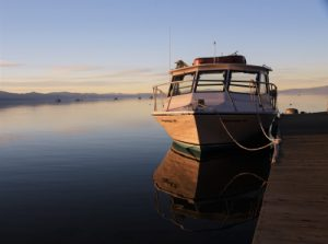 Boat at a dock in Lake Tahoe by Mark Hinte