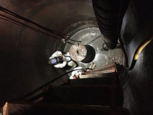 Looking down on a welder Welding a steel plate on the casing