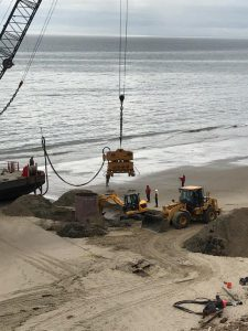 Workers preparing to remove the cofferdam