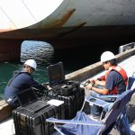 Commission personnel using remotely operated vehicle ROV to survey a container ships rudder