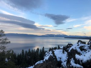 A view of Lake Tahoe from a snowy mountain top.