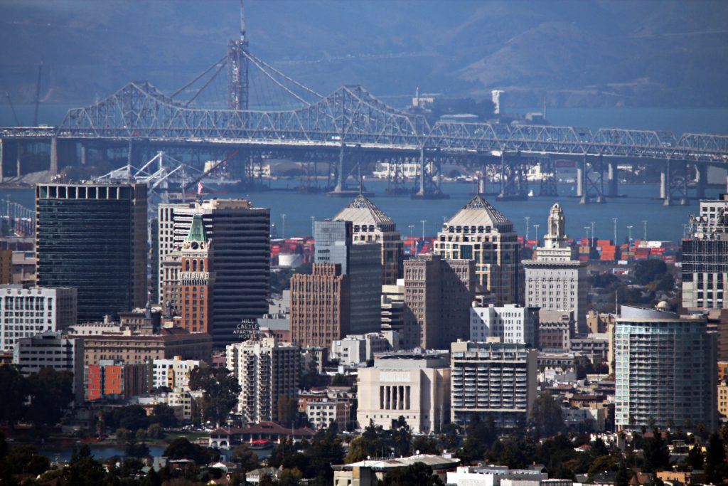 Oakland skyline, with the old eastern span of the San Francisco–Oakland Bay Bridge in background.