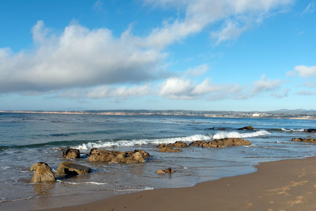 Small waves lapping on the beach of Monterey Bay.