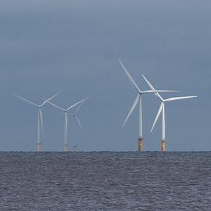 Floating wind turbines in the ocean.