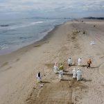 This work, Unified command continues response to oil spill off Orange County beaches [Image 5 of 5], by PO1 Richard Brahm, identified by DVIDS, must comply with the restrictions shown on https://www.dvidshub.net/about/copyright.